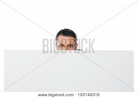 Obscured View Of Man Hiding Behind Banner Isolated On White