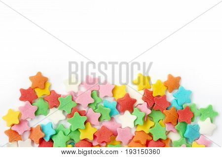 multicolored sugar sprinkling star shape on white background festive composition