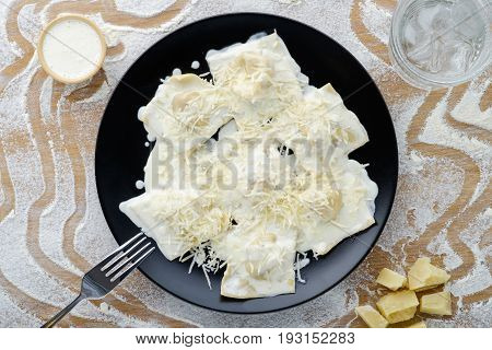 on a black plate made from a dough dish