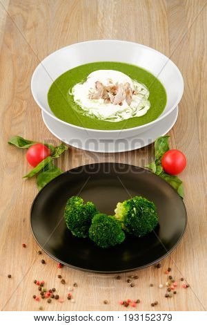 а plate of tasty hot soup with broccoli