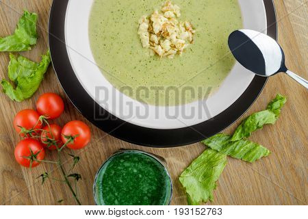 serving of cream soup with cherry tomatoes