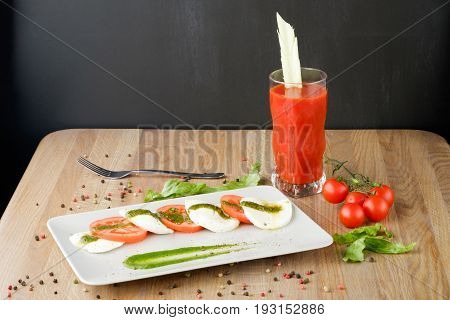 snack from tomatoes and cheese melted on the table