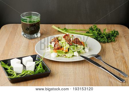 green salad with vegetables and feta cheese