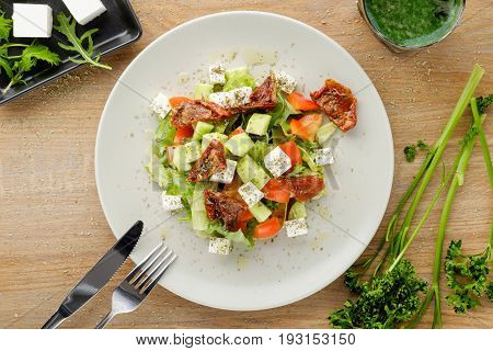 sliced summer salad served with vegetables and sauce