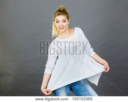 Woman Wearing Too Big Jumper