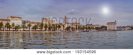 Daytime panoramic view on Riva waterfront, houses and Cathedral of Saint Domnius, Dujam, Duje, bell tower in old town, Split, Croatia