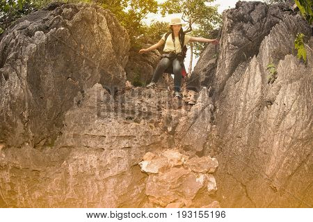 Pretty Asian woman hiking and climbing in mountains adventure and traveling.