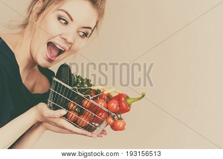 Woman Holds Shopping Basket With Vegetables