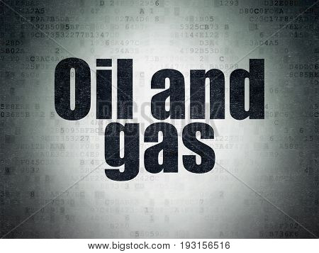 Manufacuring concept: Painted black word Oil and Gas on Digital Data Paper background