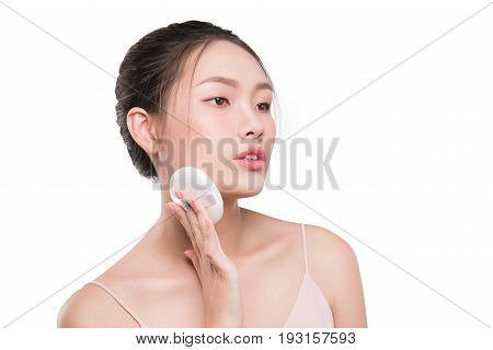 Smiling Girl Holding Powder Cushion Puff Applying Cosmetic Powder On Face