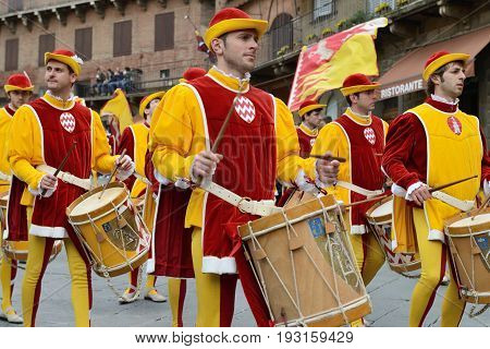 SIENA ITALY - APRIL 28: The contrada of Valdimontone (Valley of the Ram) parade through the streets of Siena in preparation for the Palio April 28 2013 in Siena Italy.