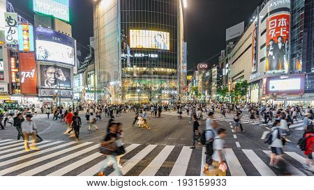 Tokyo, Japan. May 30, 2015. The shibuya district in Tokyo with many people. Shibuya is popular in Tokyo for his pedestrian cross where pedestrians cross in the same moment from all directions.