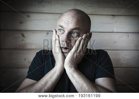 Surprised bald man