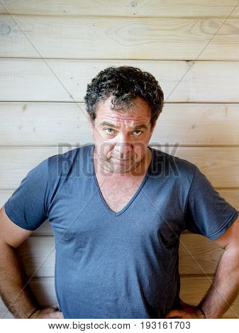 Middle-aged grumpy man in a T-shirt portrait