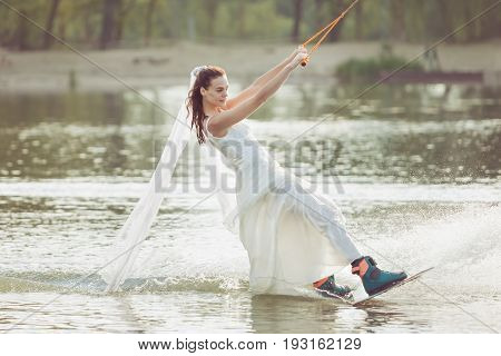 Bride in an extreme park rides a wakeboard.