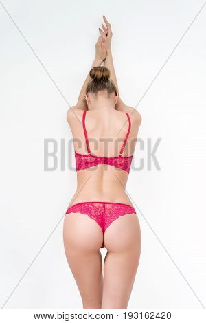 Slim, beautiful woman in lace lingerie on light background. Body parts, close up of woman half body length wearing stylish underwear. Ideal waist, perfect figure, erotic, fashionable clothes