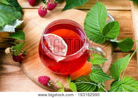 Red fruit tea with lemon and raspberry