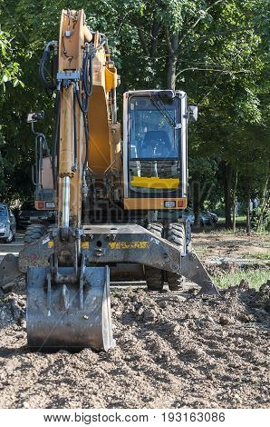 Excavator at a worksite. Digging for a parking lot.