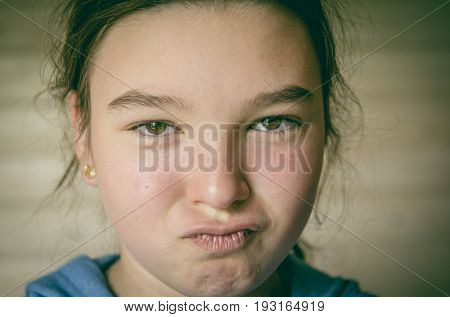 Young skeptic. Close-up portrait of a teenage girl