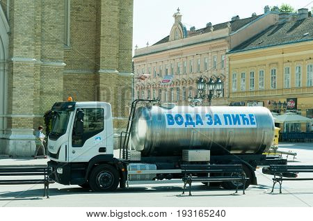 Cistern truck with fresh drinking water tank in the city for hot summer days. Translation - drinking water. June -29. 2017. Novi Sad, Serbia. Editorial image.