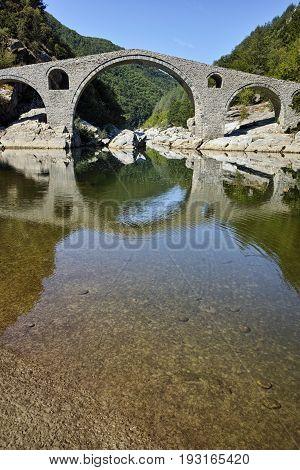 Amazing Reflection of Devil's Bridge in Arda river, Kardzhali Region, Bulgaria
