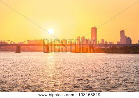 Sunsets Behind The Skyscrapers Of Yeouido And Bridges Across The Han River In South Korea.