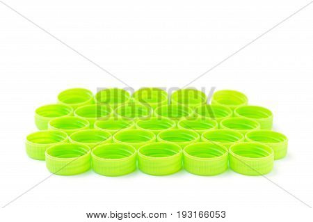 pile of green plastic bottle cap isolated on white background