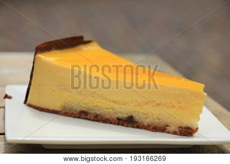 Fresh mango peach mousse confectionery with soft cake bottom
