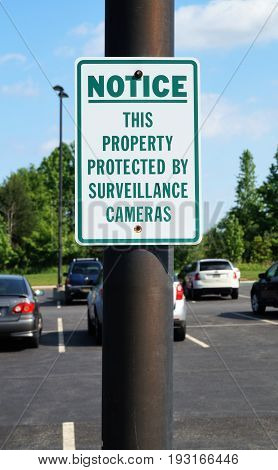 Security Camera Warning Sign. A sign on private property warning visitors of the presence of a security camera