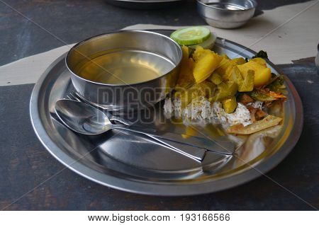 Food in Koreyan Buddhist monastery temple in Lumbini, Nepal - birthplace of Buddha Siddhartha Gautama.