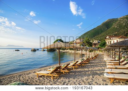 Beautiful beach with chairs and unbrellas in Nikiana village, Lefkada - Greece
