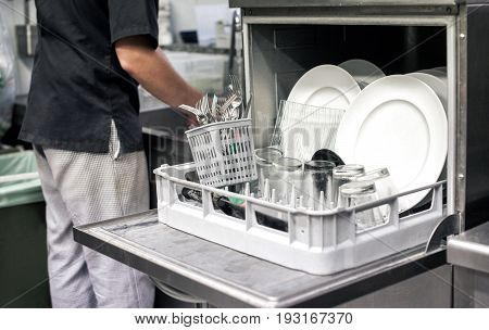 Kitchen Hand With An Open Dishwasher