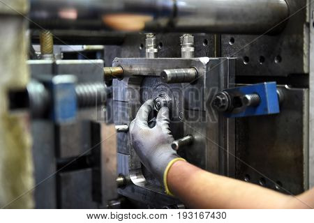 Workman Working On Large Industrial Machinery