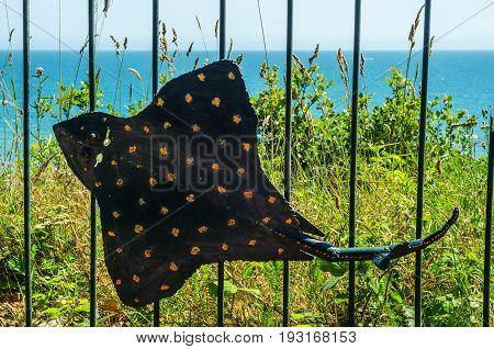 Metal Ornament On A Balustrade In A Seaside Village, Symbolic In The Shape Of Rays