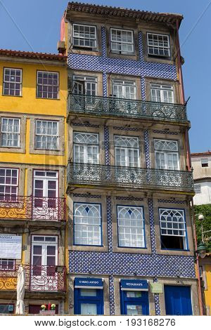 PORTO, PORTUGAL - APRIL 17, 2017: the famous houses of the Ribeira in the Douro River bank near the Dom Luis I Bridge, Porto, Portugal.