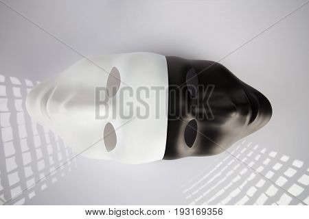 Black And White Masks Joined On White Reflective Background, Top View. Anonymity Concept..