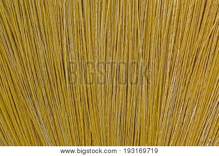Closeup texture of new clean broom made of synthetic Nylon fiber