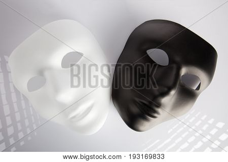 Black And White Masks On White Surface.