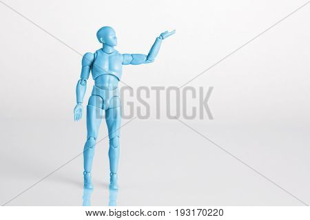 Blue Male Figurine Standing On White Reflective Table Holding One Hand Up. Making A Decision Concept