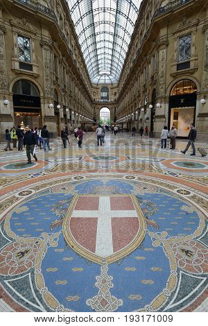 MILAN ITALY - APRIL 30: Vittorio Emmanuele II shopping gallery on April 30 2013 in Milan Italy. Inaugurated in 1865 the gallery claims to be the oldest shopping center worldwide.