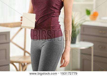 Beautiful young woman with biologically active supplement at home, closeup. Diet concept