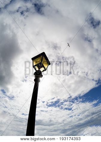 Blue Sky With White Clouds And Vintage Street Lamp