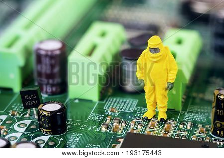 A single toy technician is repairing or diagnosing a motherboard.