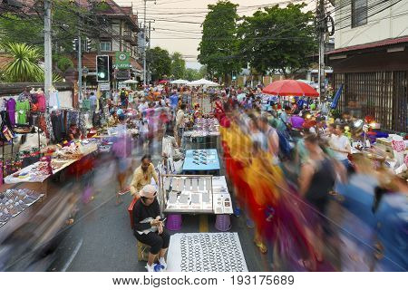 CHIANG MAI THAILAND - APRIL 17 : Sunday market walking street The city center Thai temple marketing and trading of local tourists come to buy souvenirs. on Apr 17 2016 in Chiang Mai Thailand.