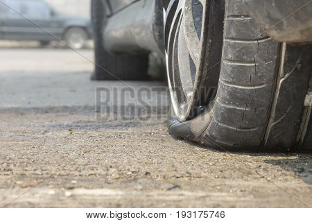 Car flat tire on road , in down town