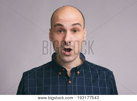 Shocked Young Bald Man With Open Mouth