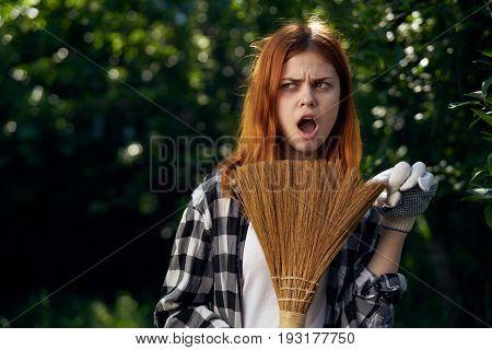 Young woman working in the garden, gardener.