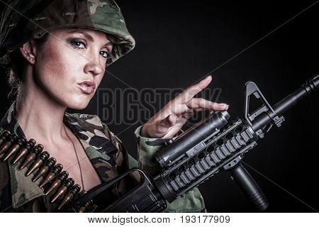 Beautiful sexy female soldier with gun