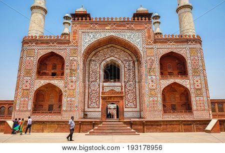 Agra India - April 30 2017 : India tourist walking pass The entrance to the Sikandra monument in Agra where Akbar the Great is buried.