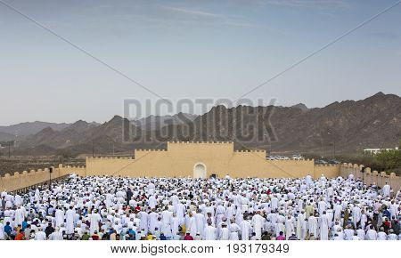 Nizwa Oman - June 26th 2017: morning prayer in an outdoor mosque in a morning of Eid Al Fitr